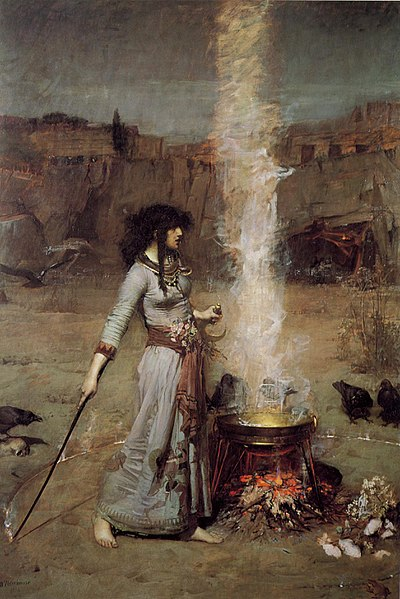 Witch performing spells by her cauldron inside a sacred circle