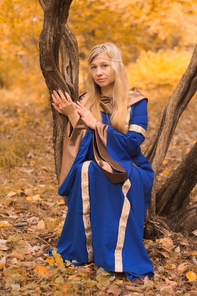witch wearing magic blue robes